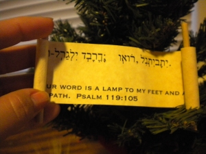 The inside of the scroll--Psalm 119:105 (the scripture for that day) in English and Hebrew